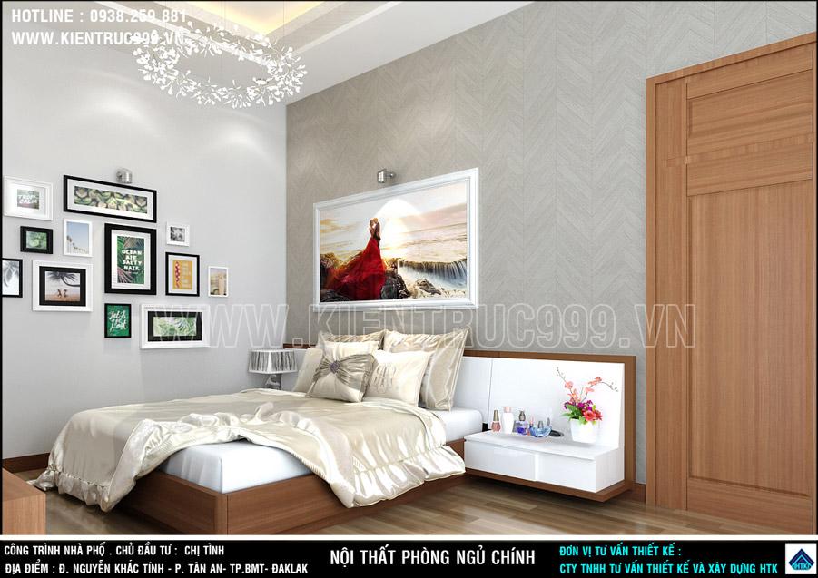 Bộ tranh bộ treo ở mảng tường kề giường ngủ lưu giữ kỷ niệm gia đình.